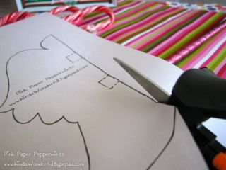 Cut the pattern for the peppermint candy cane paper angel