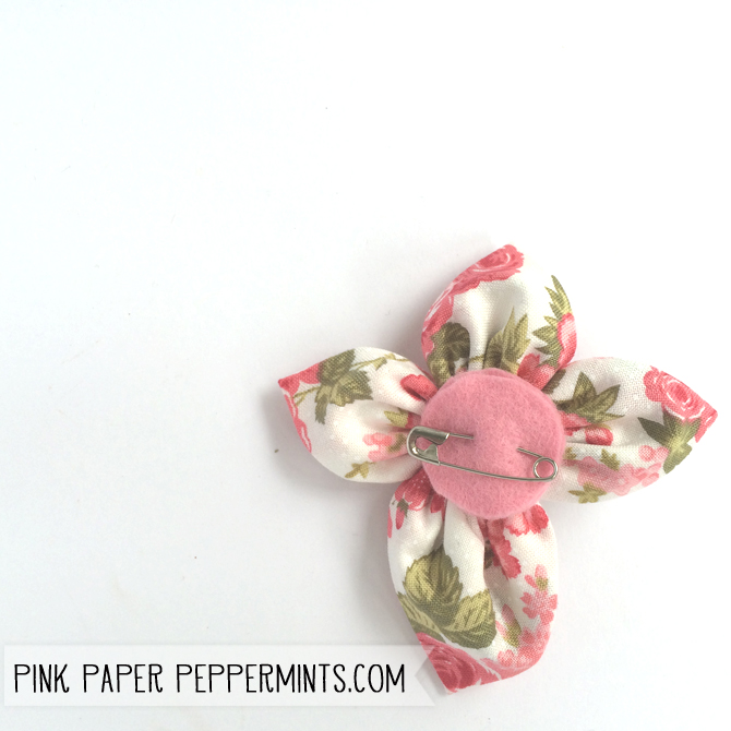Quick & Easy Easter DIY.  This fabric cross pin can be made in under an hour with just some fabric scraps, buttons and needle and thread!  Click the image for the pattern and tutorial!